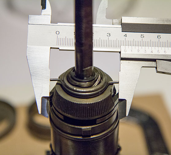 Measuring modified friction spring reach